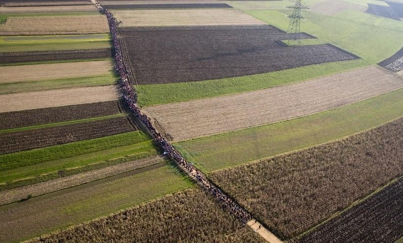 Refugees travel through Slovenia on 25 October. Photo: Maja Hitij/DPA/Corbis.
